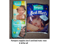 Pampers nappies and bed mats -new