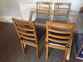 Solid oak chairs and table with glass top
