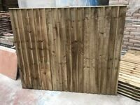 Feather edge wooden fence panels pressure treated green