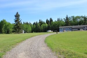 3 Bedroom Acreage with large heated shop on 4+ Acres!