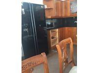 Luxury kitchen with granite worktop, integrated dishwasher and fridge