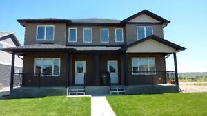 FOUR PLEX FOR RENT  OCTOBER 1 IN RANCHLANDS
