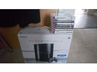Ps3 80gb in box two Sony controls with cable and 9 games