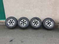 Hilux alloys with mud tyres.