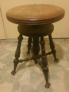 Antique piano stool in excellent condition.