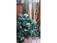Netted Sacks of Seasoned Ash Hardwood Logs
