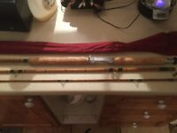 Collection of vintage and split cane and fibreglass rods