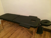 Black massage bed available for sale