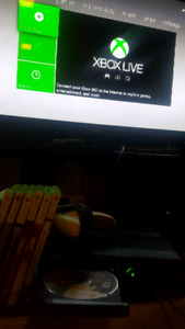 Xbox 360 slim with 500gb hardrive 2 controllers 20 games