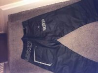For sale ZE ENZO 989 black waxed jeans new with out tags