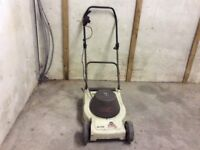 Electric lawn mower with roller