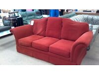 Lovely red fabric sofa in good condition.