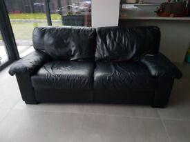 Black three seater leather sofa