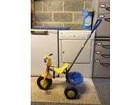 Trike with handle for pushing