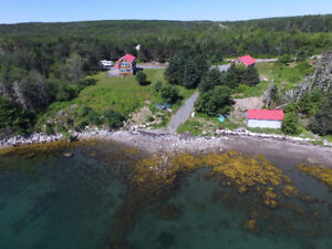 Acreage +New ocean-front home+ planned campground +30 acres