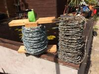 Two large rolls of Barb wire, ideal for allotment/yard/ garden security