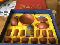 Terracotta Chinese tea set boxed and unused.