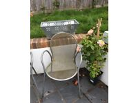 Four Patio Chairs for sale.