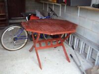 Hexagonal wood mahogany colour garden table