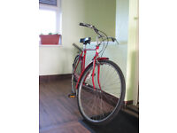 Vintage Raleigh Bicycle in cherry red