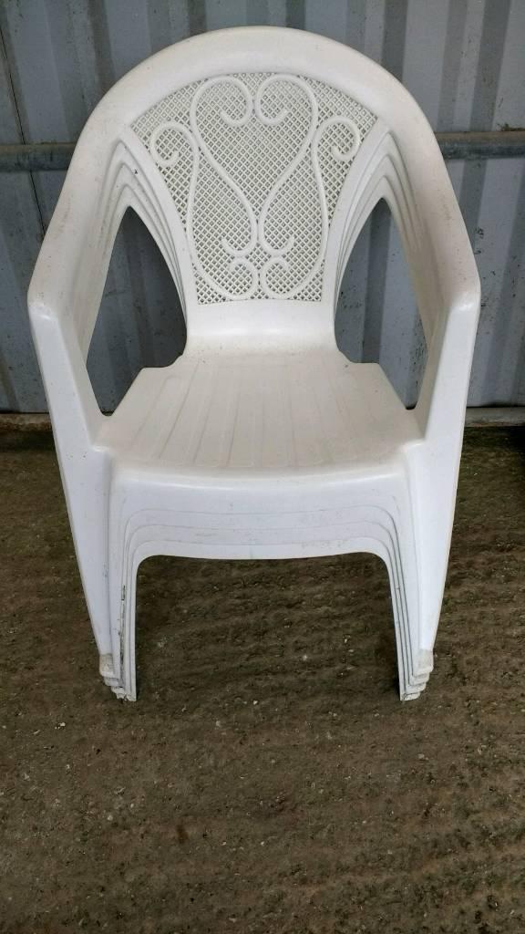 Several White & Green Garden Plastic Garden Chairs