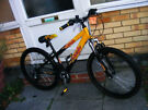 "BOYS RALEIGH 24"" WHEEL FRONT SUSPENSION BIKE IN GREAT WORKING ORDER AGE 8+"