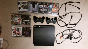 Ps3 with 2 controllers all hookups and 8 games.