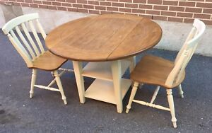 Solid wood table w/ shelf and 2 chairs