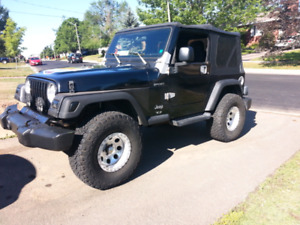 2003 Jeep Wrangler TJ 2 tops 33s on Micky Thompson Rims