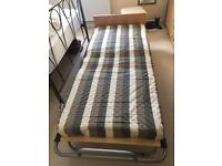 Fold up single guest bed VGC.