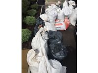Free bagged top soil and remaining sharp sand for collection