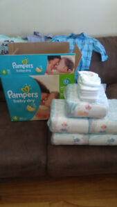 Size 4 box of Pampers&12-18m boy clothes
