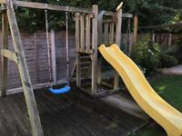 Wooden outdoor play area with swing/slide/rope ladder