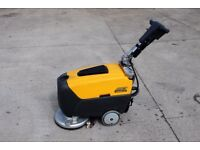 Floor scrubber drier, self propelled, battery powered with built in charger