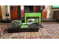 XBOX ONE and 12 games including rechargeable battery pack