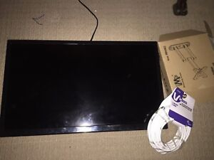 Small TV With wall mount and cable.