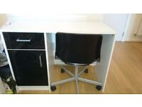 White desk with black office chair