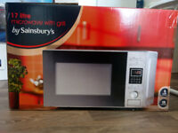 Microwave oven, with grill, 17 litres. Only 6 months old. As good as new. In his box.