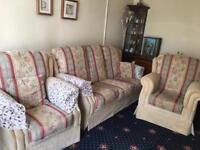 Three piece suite - two seater sofa with two armchairs