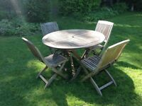 Teak garden table four 4 chairs set. Good quality.