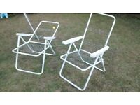 2 white garden lounger chairs