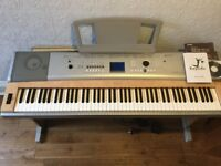 YAMAHA Portable Grand DGX-620 with stand.