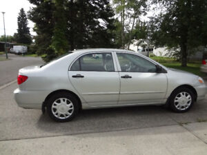 2004 Toyota Corolla w/ 2 Sets of tires with rim