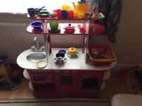 Red wooden kitchen with food and accessorises