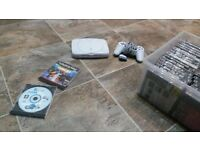 playstation 1 ps1 bundle with a box full of classic games