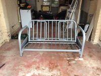 Metal sofa bed with teal mattress
