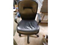 Giroflex black leather armchair