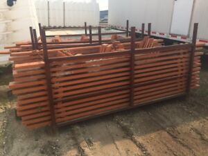 Storage racks, barricades, fabric rolls, loader attachments