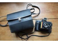 Polaroid Super Colour Swinger III with Polaroid bag