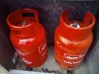 Gas bottles (EMPTY) 2 red calor propane